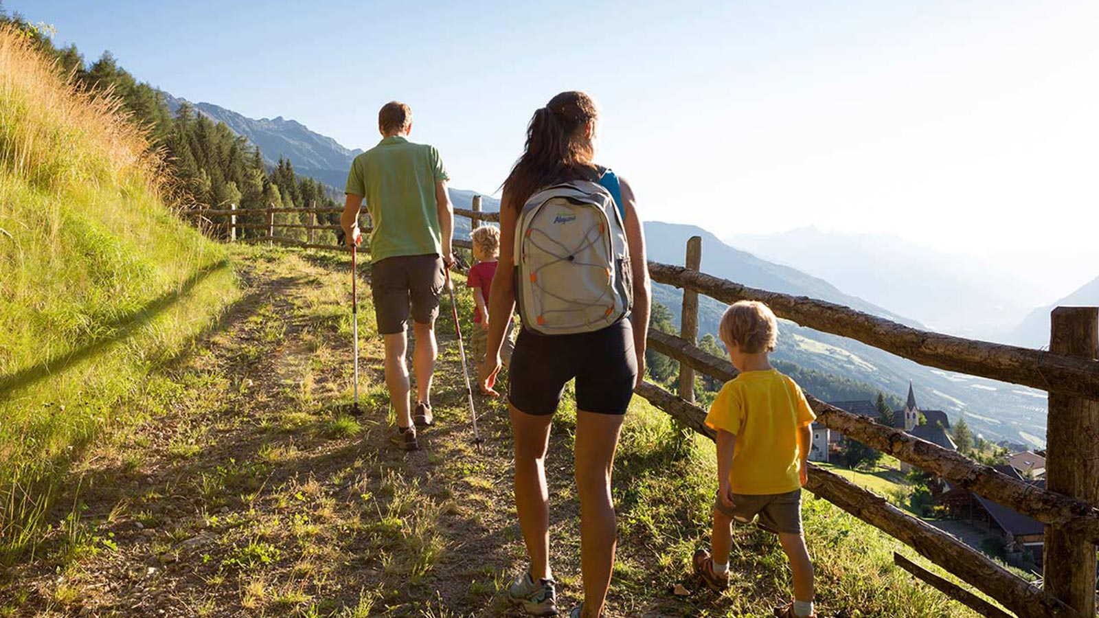 A family walking along a path during a holiday in our residence in South Tyrol for children