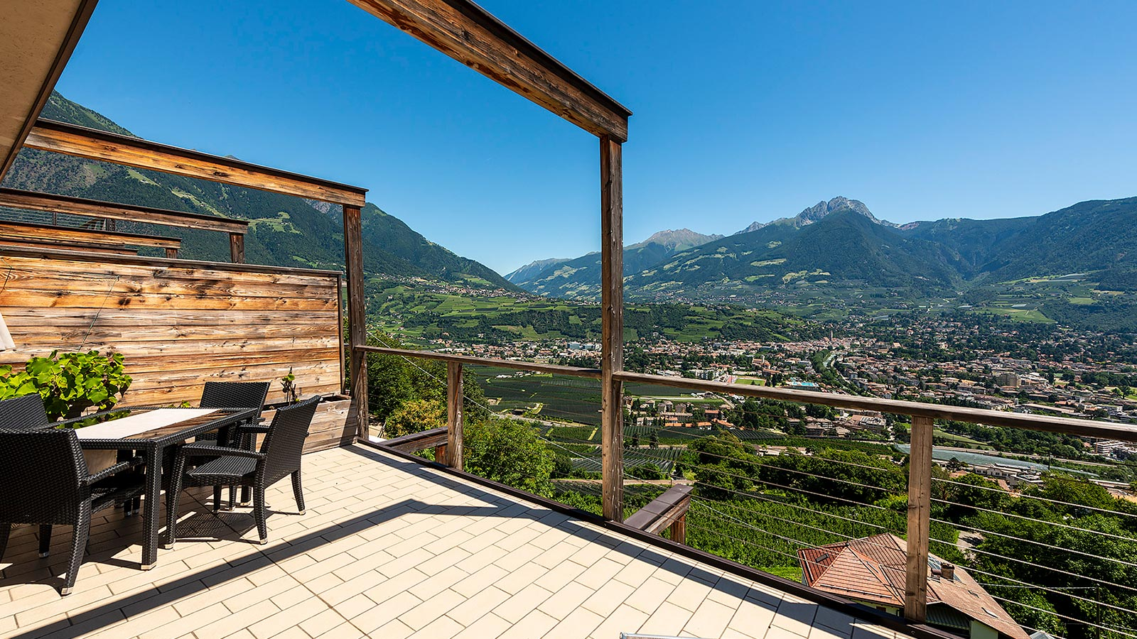 The terrace of our Residence holiday apartments in Marlengo with a view of the valley
