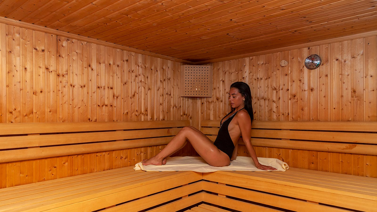A girl relaxes in the Finnish sauna of our accommodation in South Tyrol